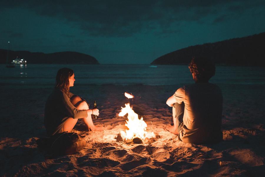 couple campfire beach outdoors