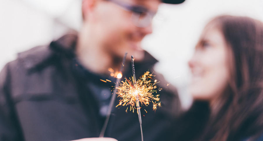 couple outdoors, sparklers